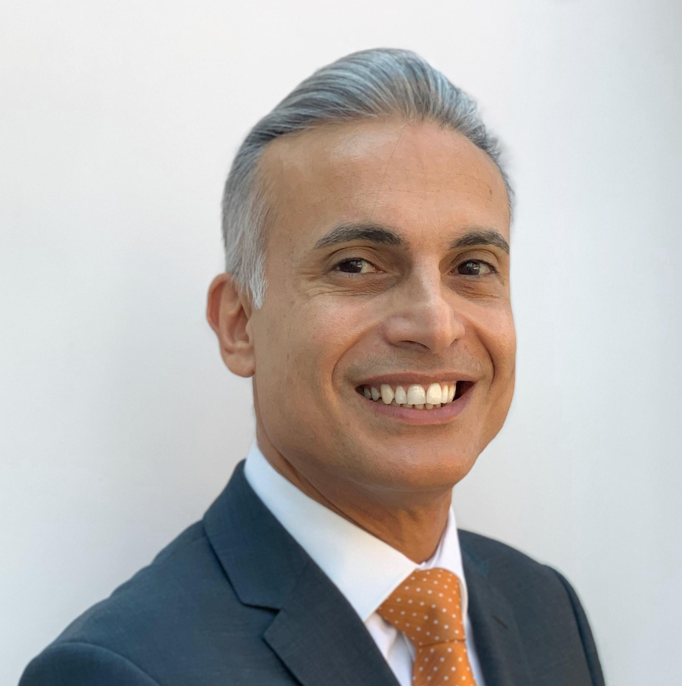 Izzet Dizdar : Finance & IT Director
